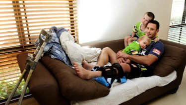 Raiders vice-captain Brett White relaxes at home with sons, Jack, 5, and Colt, 19 months, yesterday. Raiders vice-captain White is keeping a positive attitude despite his season-ending injury.