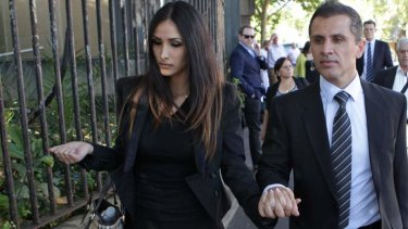 Demonstration: Simon Gittany, pictured with new girlfriend, showed the court how he attempted to save Lisa Harnum.