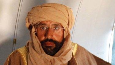 Captured ... Saif al-Islam Gaddafi on the plane to Zintan.