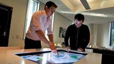 Collaborative learning ... PhD candidates at the University of Sydney Roberto Martinez and Richard Gluga with an interactive table.
