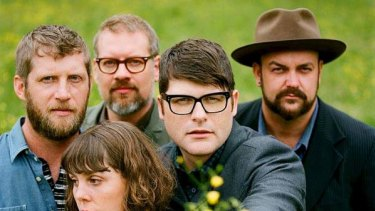 Mellow yellow ... frontman Colin Meloy, with flowers, and fellow Decemberists.
