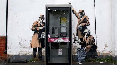 Banksy owns up to this graffiti street art on the side of a house in Cheltenham.