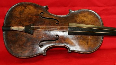 The violin that band leader Wallace Hartley played as the Titanic sank has been confirmed as genuine.