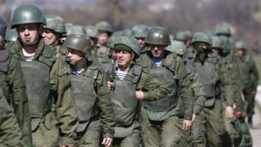 Uniformed men, believed to be Russian troops, march outside a military base in Perevalnoye, near the Crimean city of Simferopol.