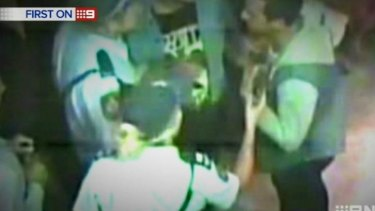 Police speak to Pearce after the incident.