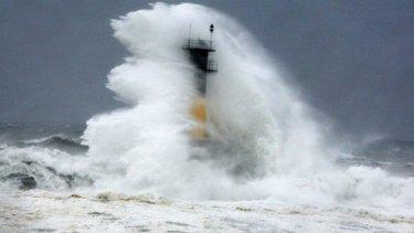 A hugeh wave hits a lighthouse as Typhoon Neoguri approaches the Korean Peninsula in Seogwipo on Jeju Island, South Korea