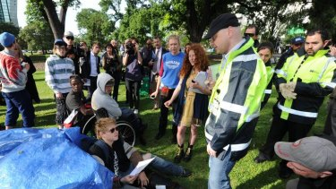 Occupy Melbourne protesters are ordered to pack up tents and other structures.