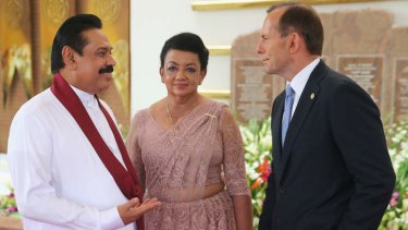Tony Abbott, pictured with Sri Lanka's President Mahinda Rajapakse and his wife, has been criticised for giving Sri Lanka two boats to deal with people smuggling.
