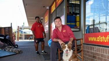 Gregory Heston with his dog Lucy outside his Melton second-hand furniture store.