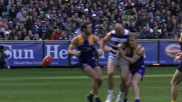James Podsiadly bumps West Coast's Adam Selwood during the second preliminary final.