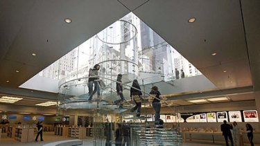 Heading to Canberra? Customers descend a glass staircase at the flagship Apple store on New York's Fifth Avenue.