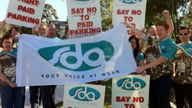Retail union members protest the introduction of paid parking at Westfield Carindale.