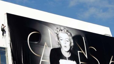 Happy birthday ... Marilyn Monroe's image promotes the 65th Cannes festival.