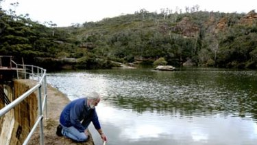 Correlation  . . . environmentalist Chris Jonkers tests the salinity of the water at Farmers Creek Dam, Lithgow.