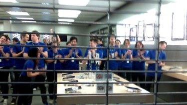 Staff at Chadstone's Apple Store on the cusp of co-ordinated craziness.