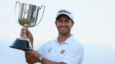 A long time coming: Adam Scott celebrates with the coveted trophy.