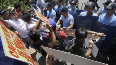 Police block environmental activists from getting closer to the US Embassy during a rally in Manila to coincide with the UN Climate Summit in New York.