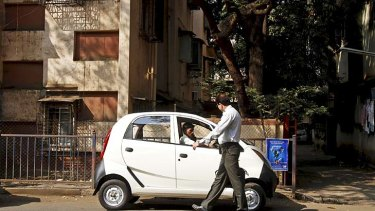 Small but well formed … a Nano parked in Mumbai. About 10,000 Nanos are sold in India each month.