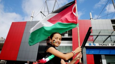 Nesreen Al-Mesqimi waves a Palestinian flag outside Hunter Stadium in Newcastle where Palestine played Japan in an Asian Football Confederation Cup match in January.