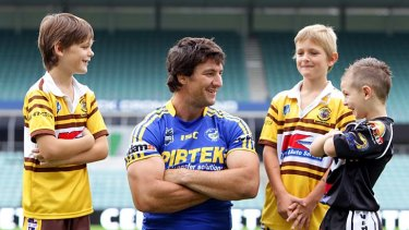 Kidding around ... Nathan Hindmarsh with Bailey and Brodie Frost and Zachary Coom.
