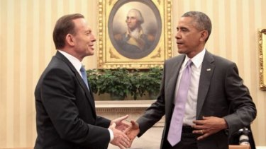 """Barack Obama meets Tony Abbott in the White House, saying """"Aussies know how to fight, and I like having them in a foxhole if we're in trouble""""."""