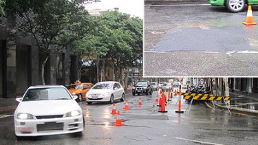 The sink hole in Felix Street in Brisbane's CBD this morning.