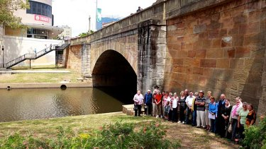 Troubled water ... heritage advocates at Lennox Bridge as it currently stands.
