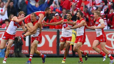 Bonded. Nick Malceski of the Swans is swamped by teammates after kicking the final goal of the 2012 AFL Grand Final.