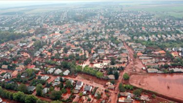 An aerial view of the red mud covering streets and neighborhood of Kolontar.