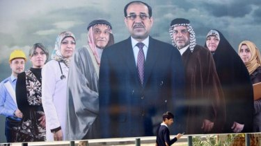 Political interference: Iraqi Prime Minister Nouri al-Maliki, seen here at the centre of an election poster in Baghdad, is accused of using electoral law to bar his rivals from office.