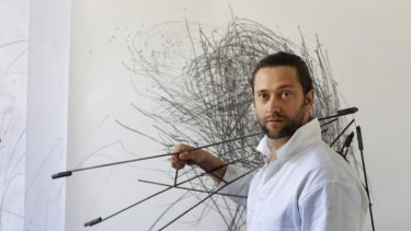 Former Slacker artist Chris Fox with his work, Instrument and Drawing, in his studio at the Sydney College of the Arts.