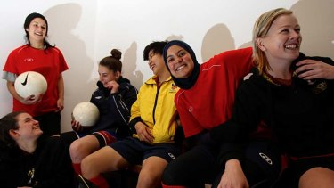 Celebrating a vital victory … Assmaah Helal wears her hijab at training with her teammates from the UNSW Eastern Lions Women's Super League squad.