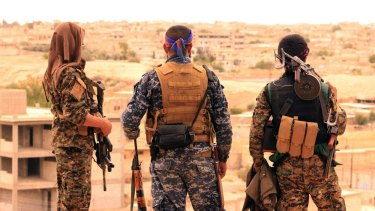Fighters from the Syrian Democratic Forces looking toward the northern town of Tabqa, Syria. US-backed Syrian forces have launched their attack on the Islamic State group's de facto capital of Raqqa, in northern Syria.