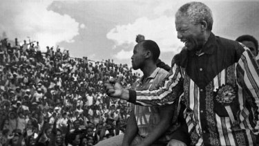Man of the people: Nelson Mandela greets crowds in 1994.