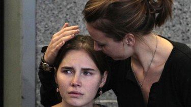 Free at last: Relieved after her ordeal, Amanda Knox is comforted by her sister Deanna Knox during a news conference in Seattle after her return home.