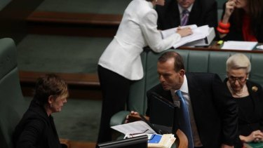 Opposition Leader Tony Abbott speaks with Deputy Speaker Anna Burke during Question Time