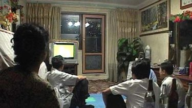 North Koreans watch the World Cup group G soccer match between Portugal and North Korea on television at an apartment in Pyongyang.