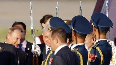 Russian President Vladimir Putin, left, arrives at the Beijing Capital International Airport in Beijing on Wednesday.