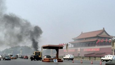 Smoke rises into the air in Tiananmen Square after a four-wheel-drive burst into flames in what Chinese authorities say was an attack by Uighur Islamists.