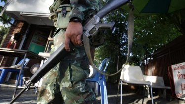 A soldier at the National Broadcasting Services of Thailand television station in Bangkok.