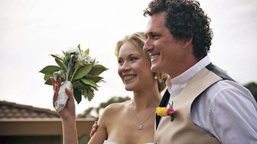 Big day … Mander and his partner, Maria, on their wedding day in Melbourne.