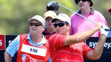 Bag man … Grant Fox watches son Ryan tee off.