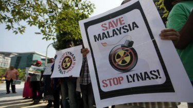 Activists hold placards during a demonstration against Lynas Corp's rare earth plant in Malaysia.