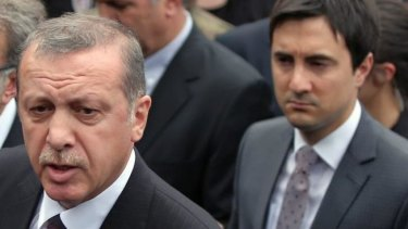 Yusuf Yerkel stands behind Prime Minister Recep Tayyip Erdogan.