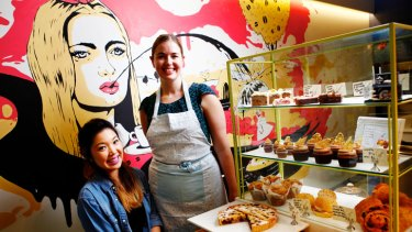 Janet Wong and Jean Cleary among the goodies at Alice Nivens Cafe in the heart of Melbourne. The enterprising pair bake the lot in their tiny kitchen.