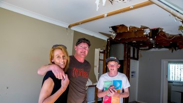 Tracey and Gavin Sant with oldest child Drew, 14, inside their damaged home at Kurnell.