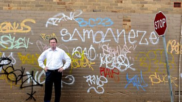 We've had a gutful...NSW Premier Nathan Rees stands in Cox Lane, Toongabbie, near his home in Western Sydney. Juveniles must now have a legitimate reason for having spray paint on their person