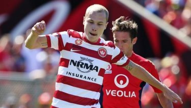 Tight: Aaron Mooy on the ball against Adelaide.