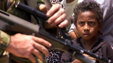 Despite the look of apprehension on this boy's face, Australian peacekeeping soldiers were welcomed by the East Timorese refugees in 1999.