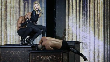 Courting controversy ... Madonna on stage at the Stade de France in Saint-Denis, Paris.